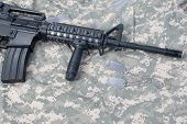 foto of m4  - M4 carbine with blank dog tags on camouflage uniform - JPG