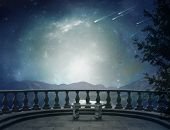 Постер, плакат: Balcony and landscape Elements of this image furnished by NASA