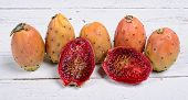 picture of prickly pears  - Prickly pears on a white wooden table - JPG