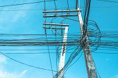 picture of utility pole  - image of electric pole and blue sky on sunny day - JPG