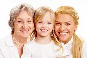 image of mother daughter  - Faces of grandmother with adult daughter and grandchild in line - JPG