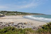 pic of west village  - Coverack beach Cornwall England UK with white waves coastal fishing village on the Lizard Heritage coast South West England on a sunny summer day - JPG