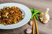 stock photo of scallion  - Crisp noodles with chicken and soy sauce topped with scallions and garlic - JPG