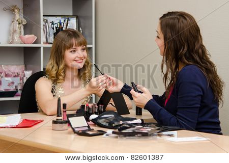 Beauty Consultant Gives The Client A Brush For Eyelashes