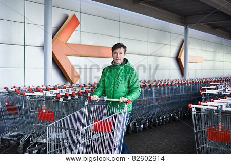 Man With Shopping Cart On Parking