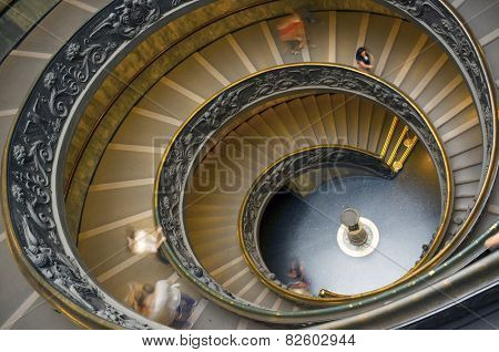 VATICAN CITY, VATICAN STATE - SEPTEMBER 22, 2014: The double helix staircase designed by Giuseppe Momo in 1932, inspired by the revolutionary spiral staircase designed by Donato Bramante