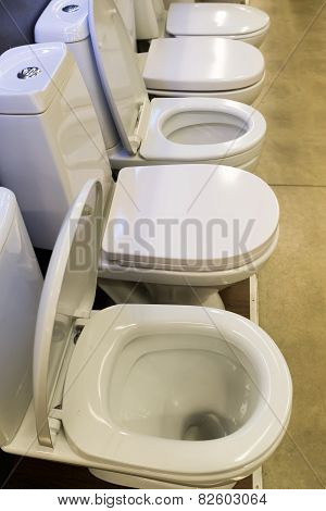 Toilets in a store standing at  row