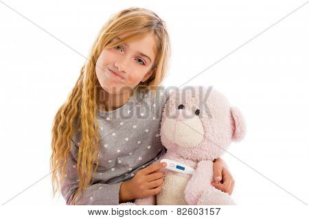 blond girl with teddy bear thermometer and flu cold in pajama