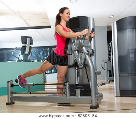 Gym glute exercise machine woman workout indoor