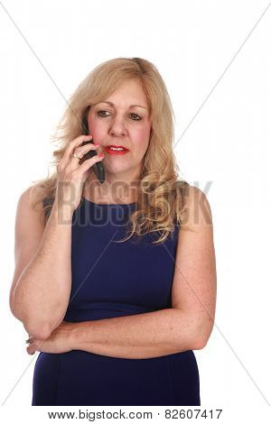 A mature woman talking on her cell phone. Isolated on white with room for your text