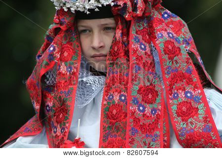 VLCNOV, CZECH REPUBLIC - MAY 26, 2013: Young boy Ondrej Franta elected to play the King attends the Ride of the Kings folklore festival in Vlcnov, South Moravia, Czech Republic.