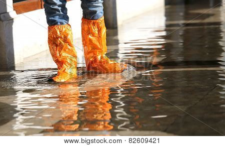 Woman With Gaiters At High Tide In Venice