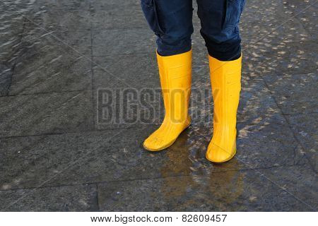 Woman With Boots At High Tide In Venice