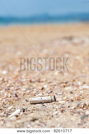 Cigarette Butt Discarded Left On Beach, Concept Photo.