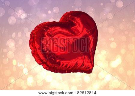Red heart balloon against pink abstract light spot design