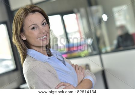 Smiling businesswoman with satisfied look