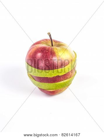 isolated striped apple, made of two different colors - green and red. horizontal section