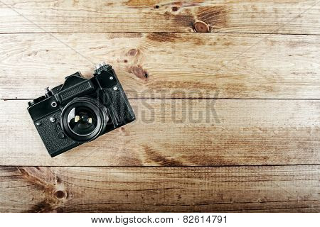 Old Vintage Photo Camera On Wooden Table