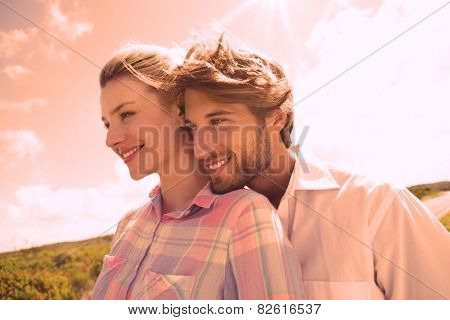 Smiling couple standing outside together on a sunny day