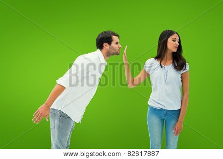 Brunette uninterested in mans advances against green vignette