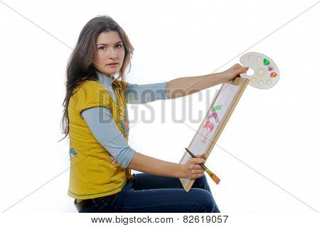 Woman Artist Sitting Sideways To The Camera Holding An Easel