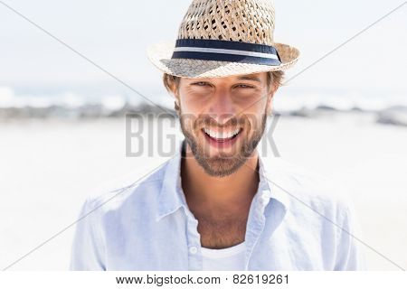 Handsome man smiling at camera on promenade on a sunny day