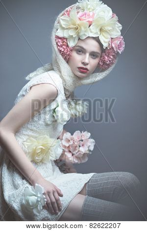 Girl with flowers on her head in a dress in the Russian style. Fog effect.
