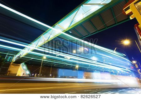 Traffic blur motion trails in modern city street at night