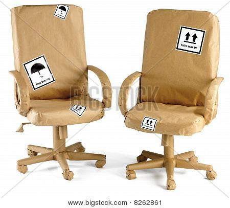 Office Chairs All Wrapped Up In Brown Paper For A Move