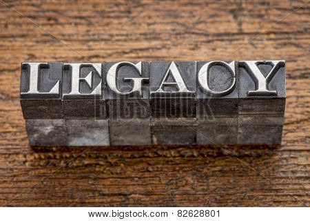 legacy  word in mixed vintage metal type printing blocks over grunge wood