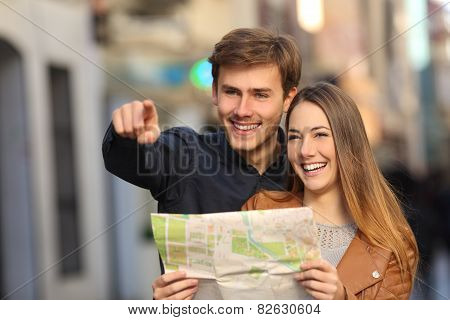 Couple Of Tourists Searching A Street In A Map
