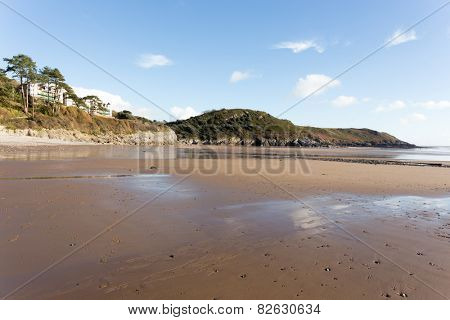 The huge surfing beach of Caswell Bay, on the South Wales Coast Path, at low tide