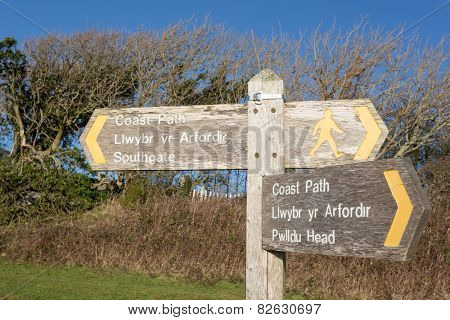 A signpost for the Wales Coast Path between Southgate and Pwlldu Head on the Gower, South Wales, UK
