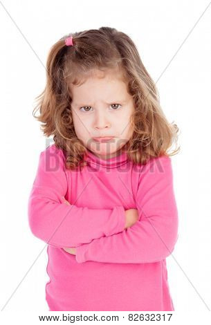 Angry little girl in pink isolated on a white background