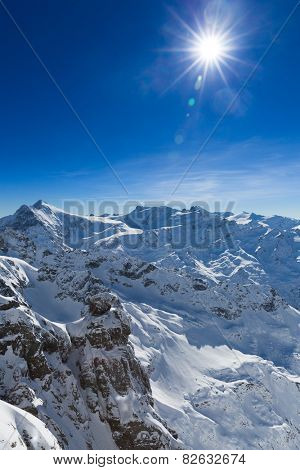 Beautiful view from the Swiss mountain Titlis towards the South. On the horizon from left to right you can see the mountains Sustenhorn, Dammastock, Tierberge and Diechterhorn.