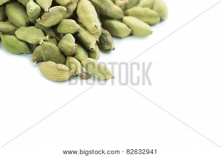 Lots Of Cardamom Pods On White Background