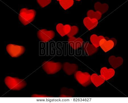 red heart bokeh on dark background