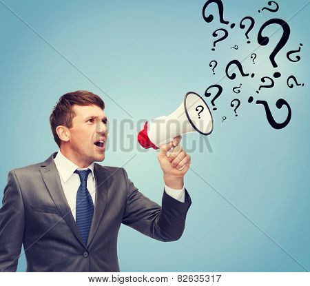 business, communication, hiring, searching, public announcement, office concept - buisnessman with bullhorn or megaphone and question marks