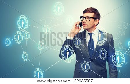 business, communication, modern technology and office concept - buisnessman with cell phone