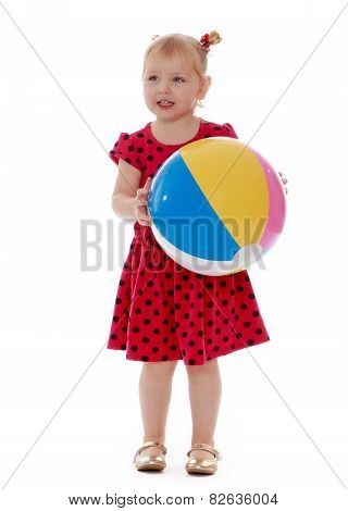 smiling child with the ball in his hands.