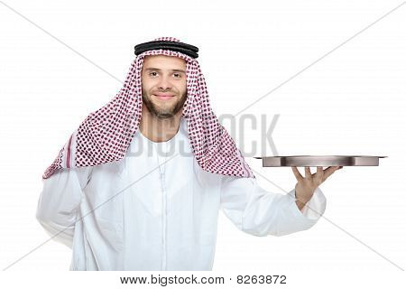 An arab person holding a tray
