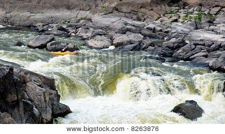 Kayaker Running Rapids