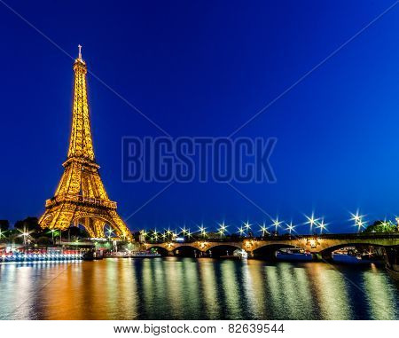 PARIS - JUNE 15: Eiffel Tower on June 15, 2012 in Paris. Eiffel tower is one the most popular attractions in Paris