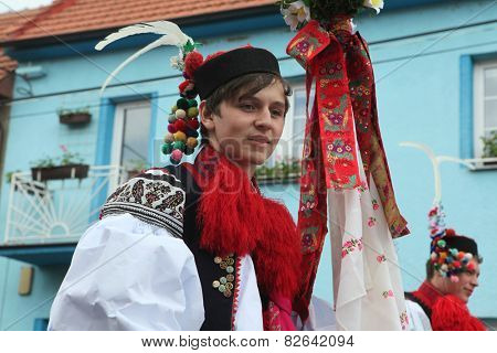 VLCNOV, CZECH REPUBLIC - MAY 26, 2013: Young man dressed in traditional Moravian folk costume perform the Recruit during the Ride of the Kings festival in Vlcnov, South Moravia, Czech Republic.