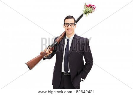 Businessman holding a rifle loaded with flowers isolated on white background