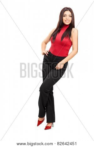 Full length portrait of a fashionable girl leaning against a wall isolated on white background