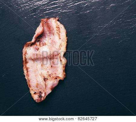 Delicious bacon on a black background