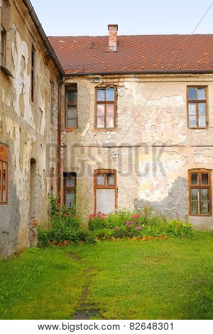 backyard and aged facade of old house in Pljevlja, Montenegro