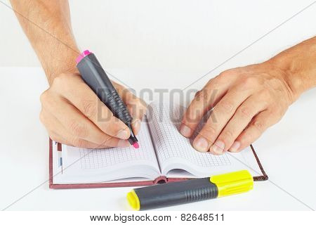 Hand written notes in red marker a notepad on white background