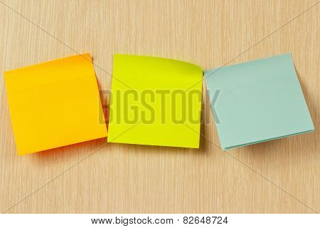 Colorful stickers on a wooden board